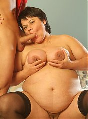BBw Belane wears her sexy stockings as she gets fucked hard on the bed